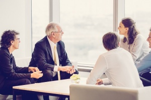 Image of Business Team Discussing Ideas in Lounge