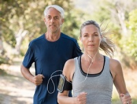 Image of man and woman running.