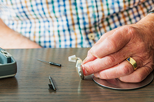 Hearing aid being cleaned